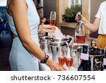 pouring champagne into glass at ... | Shutterstock . vector #736607554