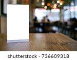 mock up menu frame standing on... | Shutterstock . vector #736609318