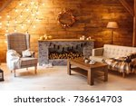 home comfort. armchair near the ... | Shutterstock . vector #736614703
