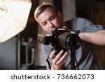 the young man adjusts the... | Shutterstock . vector #736662073