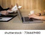 working woman's hands sitting... | Shutterstock . vector #736669480
