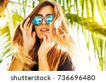 woman wearing sunglasses posing ... | Shutterstock . vector #736696480