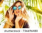 woman wearing sunglasses posing ... | Shutterstock . vector #736696480
