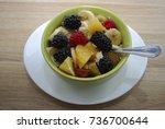 fruit and berry salad  oranges  ... | Shutterstock . vector #736700644