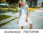beautiful woman street... | Shutterstock . vector #736724938