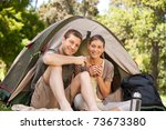 happy couple camping | Shutterstock . vector #73673380
