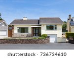 bungalow house with garage   Shutterstock . vector #736734610