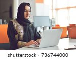 muslim asian woman working in... | Shutterstock . vector #736744000