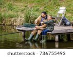 father and son fishing together ... | Shutterstock . vector #736755493