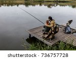Father And Son Fishing Togethe...