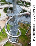 Small photo of LIPNO NAD VLTAVOU, CZECH REPUBLIC - 26 September 2017. Spiral slide tube in the middle of The Treetop Walkway, Lipno nad Vltavou, Czech Republic.