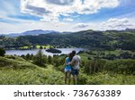 couple in alcock tarn | Shutterstock . vector #736763389