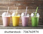sweet smoothie in plastic cups... | Shutterstock . vector #736763974