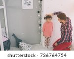 father is measuring his baby... | Shutterstock . vector #736764754