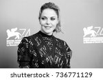 Small photo of VENICE, ITALY - SEPTEMBER 06: Claudia Gerini attends the photo-call of the movie 'Ammore E Malavita' during the 74th Venice Film Festival on September 6, 2017 in Venice, Italy.