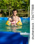 father and daughter swim in... | Shutterstock . vector #736777888
