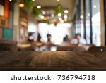 empty dark wooden table in... | Shutterstock . vector #736794718