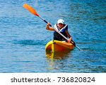 kayaking lessons. boy with ... | Shutterstock . vector #736820824