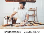 baker with a variety of healthy ... | Shutterstock . vector #736834870
