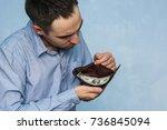 the guy counts the money in his ... | Shutterstock . vector #736845094