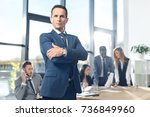 handsome businessman looking at ... | Shutterstock . vector #736849960