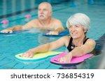 elderly doing aqua exercises in ... | Shutterstock . vector #736854319