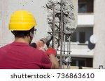 construction worker using a... | Shutterstock . vector #736863610