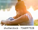 portrait of woman outdoors in a ... | Shutterstock . vector #736897528