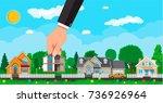 hand picks a house. suburban... | Shutterstock . vector #736926964