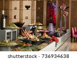 seafood and salad buffet served ... | Shutterstock . vector #736934638