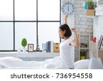asian women she is in bed and... | Shutterstock . vector #736954558