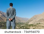 afghan man from behind with... | Shutterstock . vector #736956070