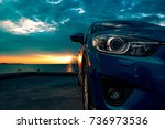 blue compact suv car with sport ... | Shutterstock . vector #736973536