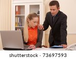boss  harass to his admin/office staffperson touching her shoulder - stock photo