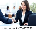 close up of a handshake of a...   Shutterstock . vector #736978750
