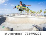 skateboarder catches air at... | Shutterstock . vector #736990273