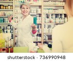 cheerful  mature female seller... | Shutterstock . vector #736990948