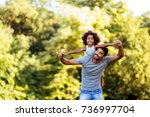 portrait of young father... | Shutterstock . vector #736997704