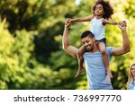 portrait of young father... | Shutterstock . vector #736997770