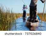 people in canoes  okavango... | Shutterstock . vector #737026840