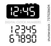 a classic set of digital alarm... | Shutterstock .eps vector #737028604