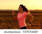 athletic woman running on rural ... | Shutterstock . vector #737073409