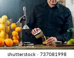 the hand juicer. man pours the... | Shutterstock . vector #737081998