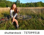 teenager girl sit with  bicycle ... | Shutterstock . vector #737099518
