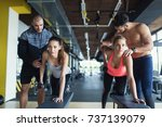 young women in gym doing... | Shutterstock . vector #737139079