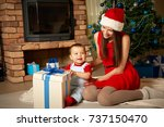 mother and child celebrating at ... | Shutterstock . vector #737150470