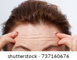 macro woman face with wrinkles...   Shutterstock . vector #737160676