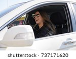 happy young woman driving her... | Shutterstock . vector #737171620
