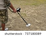 Small photo of man with metal detector in perlustration on a beach