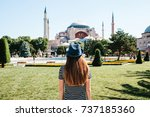 a young girl traveler in a hat... | Shutterstock . vector #737185360